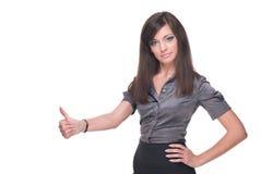 Fermez-vous vers le haut de la verticale du femme d'affaires. Pouces vers le haut ! Photo stock
