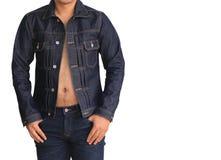 Fermez-vous vers le haut de la veste de denim de jeans Images stock