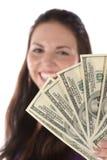 Fermez-vous vers le haut de la vue de la pile du dollar dans la main femelle Photographie stock