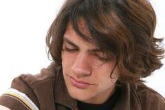 Fermez-vous vers le haut de pleurer de l'adolescence de garçon image libre de droits
