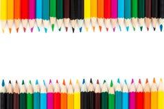 Fermez-vous vers le haut des crayons de couleur d'isolement sur le fond blanc Images stock