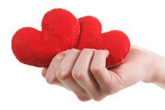 Fermez-vous vers le haut des mains avec la forme de coeur, blanc d'isolement par concept de soin et d'amour Photographie stock libre de droits