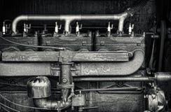 Fermez-vous vers le haut du détail d'un moteur tracteur de vintage Photos stock