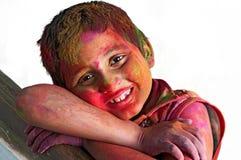 Fermez-vous vers le haut du face_boy_Holi_colors_white BG Photos libres de droits
