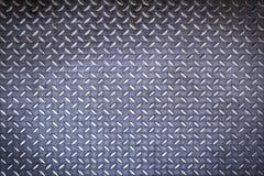 Fermez-vous vers le haut du fond de plaque d'acier de diamant Photo libre de droits