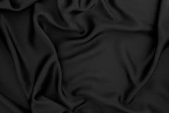 Fermez-vous vers le haut du fond rouge de tissu de soie ou de satin de vague image stock