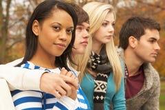 Fermez-vous vers le haut du groupe de quatre amis d'adolescent Photographie stock