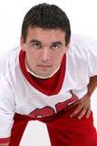 Fermez-vous vers le haut du jeune homme dans le football Jersey Images stock