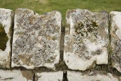 Fermez-vous vers le haut du mur de pierres sèches Photographie stock