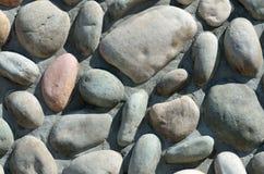 Fermez-vous vers le haut du mur en pierre Image stock