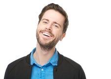 Fermez-vous vers le haut du portrait d'un jeune homme heureux avec la barbe Photographie stock libre de droits