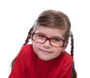 Fermez-vous vers le haut du portret des verres de port de petite fille Image libre de droits