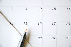 Fermez-vous vers le haut du stylo de couleur la date quinze Photo stock