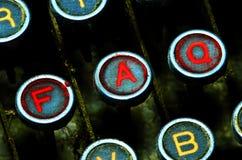 Fermez-vous vers le haut sur des clés de FAQ de machine à écrire Photographie stock libre de droits
