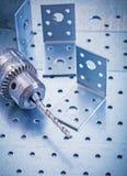 Fermi di angolo e trapano perforati inossidabili del metallo Immagini Stock