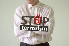 Fermi il concetto del terrorismo Un uomo in un bianco Immagini Stock