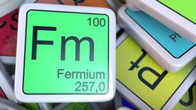 Fermium Fm block on the pile of periodic table of the chemical elements blocks. 3D rendering. Fermium tag on the pile of periodic table of the chemical elements Stock Photo
