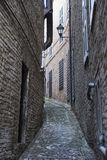 Fermo Marches, Italy. Historic buildings along an old typical alley Stock Images