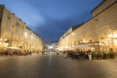 Fermo Marches, Italy. Historic buildings along the historic main square of the city at evening. People Royalty Free Stock Photography