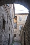 Fermo Marches, Italy. Historic buildings along an old typical alley Stock Photo