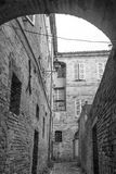 Fermo Marches, Italy. Historic buildings along an old typical alley. Black and white Royalty Free Stock Photo