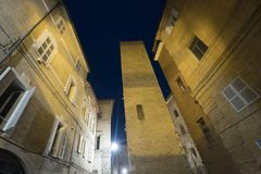 Fermo Marches, Italy. Historic buildings along an old typical alley at evening Stock Photography