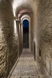 Fermo Marches, Italy. Historic buildings along an old typical alley at evening Royalty Free Stock Image