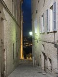Fermo Marches, Italy. Historic buildings along an old typical alley at evening Stock Images