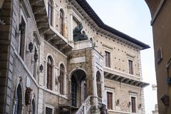 Fermo Marches, Italy. Historic buildings along an old typical street at evening Stock Photos
