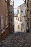 Fermo Marches, Italy. Historic buildings along an old typical street Stock Image