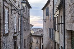 Fermo Marches, Italy. Historic buildings along an old typical street Stock Photos