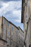Fermo Marches, Italy. Historic buildings along an old typical street Stock Photo