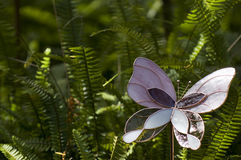 Fern Garden and Glass Butterfly Stock Image