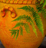 Fern in Terra Cotta Pot. The colors of the green fern contrast nicely with the orange of the terra cotta clay pot. Came across this delightful color combination Stock Photo