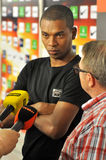 Fernandinho listens to an interpreter. The Manchester City midfielder, Fernandinho, who arrived in Donetsk, answered the journalists' questions at Donbass-Arena Royalty Free Stock Photo