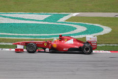 Fernando Alonso in action. Fernando Alonso  in action at sepang circuit of Malaysia Grand Prix Stock Photo