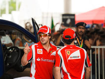 Fernando Alonso and Felipe Massa, team Scuderia Fe. Autograph session at Formula 1 GP, April 10 2011 in Sepang, Malaysia. Fernando Alonso and Felipe Massa, team Stock Image