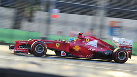 Fernando Alonso racing in F1 Singapore GP Stock Photo