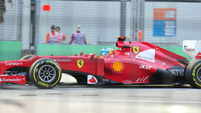 Fernando Alonso racing in F1 Singapore GP Stock Photography
