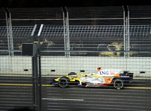 Fernando Alonso speeding at F1 night race Stock Image