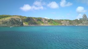 Fernando de Noronha Island, a UNESCO World Heritage site, Pernambuco, Brazil - July, 2019 - 4k footage at Porto Santo Antonio. Beach with the view of Pico Hill stock video