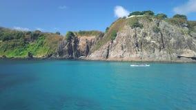 Fernando de Noronha Island, a UNESCO World Heritage site, Pernambuco, Brazil - July, 2019 - 4k footage of Sea kayaking, canoeing,. In a beautiful sea water at stock video footage