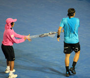 Fernando Gonzalez changing racquet Stock Image