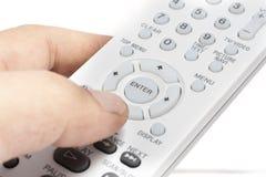 Ferncontroller mit der Hand Stockbild