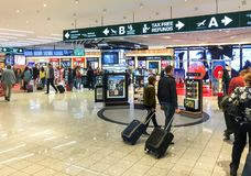 Duty Free Shop, passengers make purchases before departure in Milan Malpensa International Airport. Ferno, Milan, Italy - May 5, 2018: Duty Free Shop Stock Image