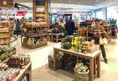 Duty Free Shop, passengers make purchases before departure in Milan Malpensa International Airport. Ferno, Milan, Italy - May 5, 2018: Duty Free Shop Royalty Free Stock Photos