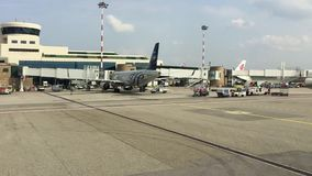 View of Milan-Malpensa airport Terminal 1 from the moving aircraft. stock video footage