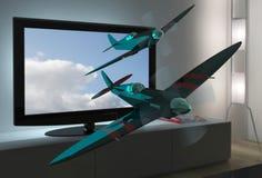 Fernsehapparat 3D mit den Spitfireflugzeugen, die heraus fliegen Stockfotos