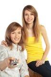 Fernsehapparat Uhr der jungen Frauen Lizenzfreie Stockfotos