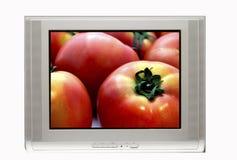 Fernsehapparat und Tomate Stockbilder